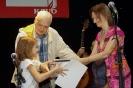 Марию Чертихину награждают Дмитрий Сухарев и Юлия Софронова